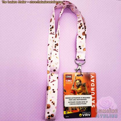 Sweet Treats Lanyard, a cute lanyard featuring cakes, cookies and candy.